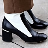 We love the minimalist take on these black and white boots.