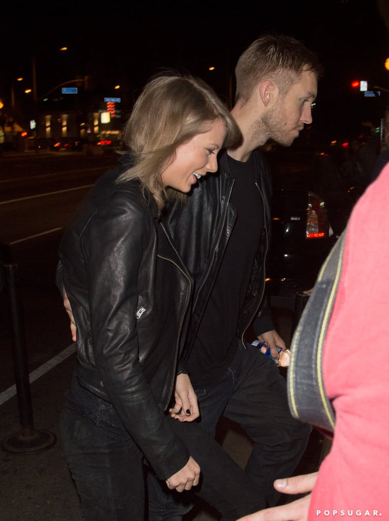 """Taylor Swift was all smiles while holding Calvin Harris's hand on Thursday night. Just a week after Taylor and Calvin spent time together in Nashville, the pair was spotted showing some sweet PDA in LA. Both rocking all-black outfits, they went to Haim's concert in West Hollywood, where Taylor was spotted sitting in his lap. While Alana, Danielle, and Este Haim are among Taylor's circle of friends, Calvin worked with the sisters for the song """"Pray to God."""" Keep reading to see pictures of Taylor and Calvin's night out, then see the surprising link between Taylor's boyfriends and BFFs."""