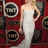 Naomi Watts drew the eye with a body-skimming fit and high-shine embellishments on her Marchesa gown.