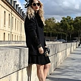 This styler livened up an all-black ensemble with studded Zara heels and a fascinator.