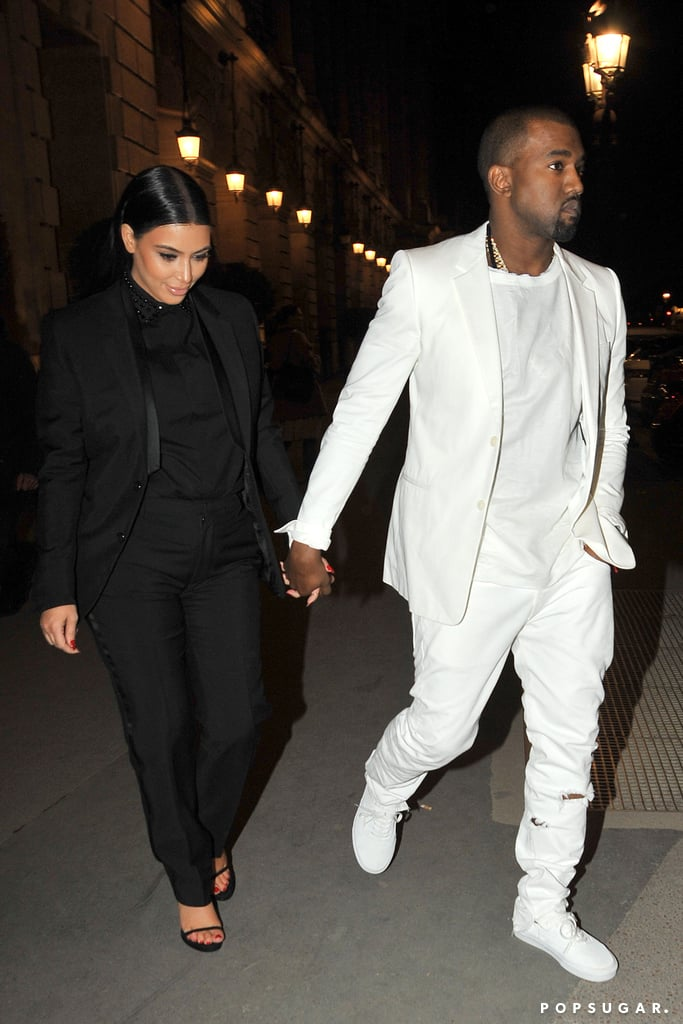 Kim Kardashian and Kanye West held hands as they walked around Paris together yesterday. They stepped out in the City of Light after attending the Givenchy runway show, where Kanye helped Kim adjust her shoe in the front row. Nicole Richie was also on hand for the presentation, adding to the list of stars at Paris Fashion Week so far. Kim made the trip to France on Saturday, and while she was busy traveling, Kanye checked out the Céline show. The couple wrapped up their weekend last night when they met up with friends, including Ciara and Frank Ocean, following the fashion week festivities.