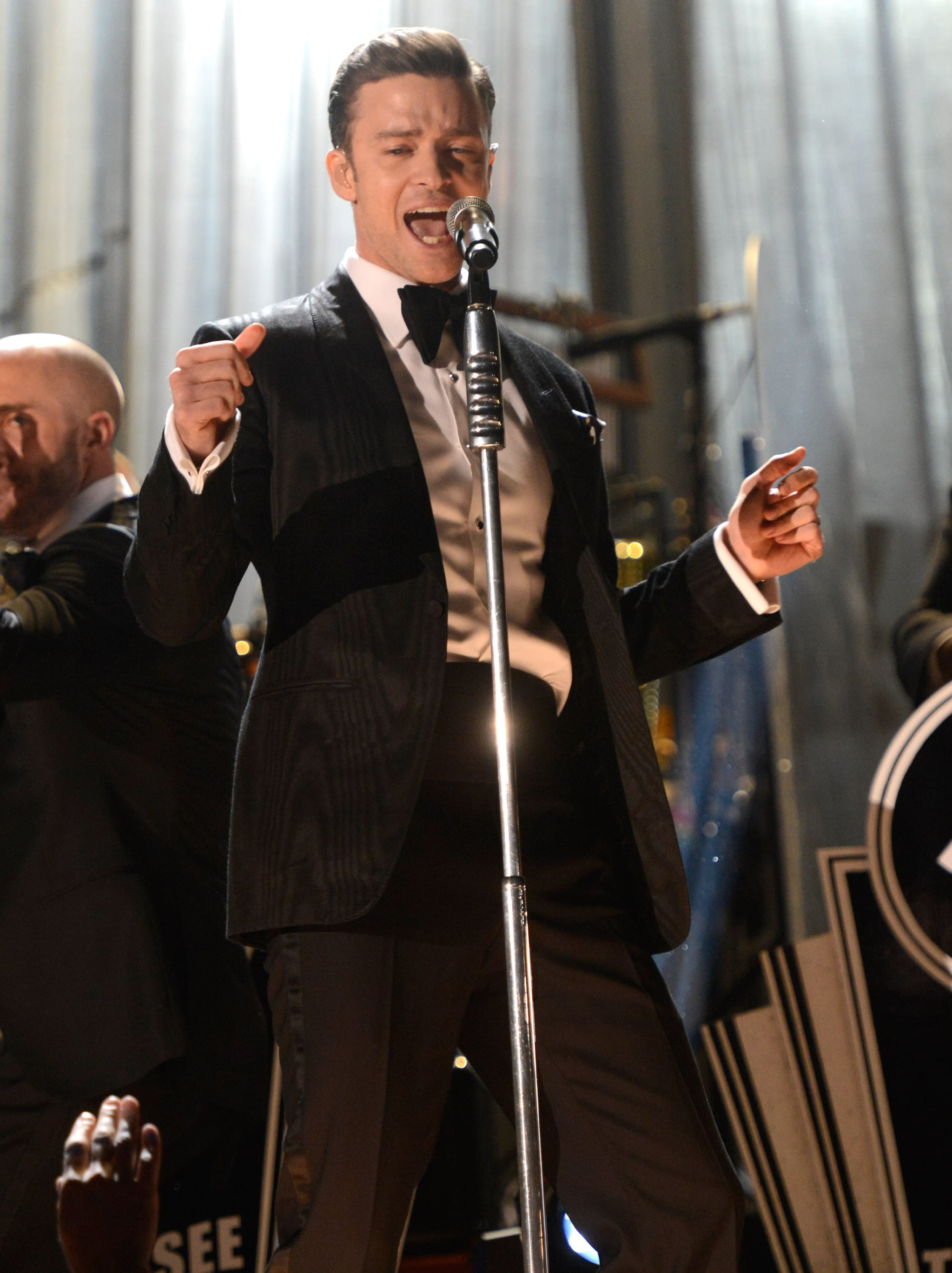 Justin Timberlake danced as he sang into the microphone Sunday night at the 2013 Grammys.
