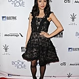 Wearing a sheer black minidress at the The Book of Love premiere.