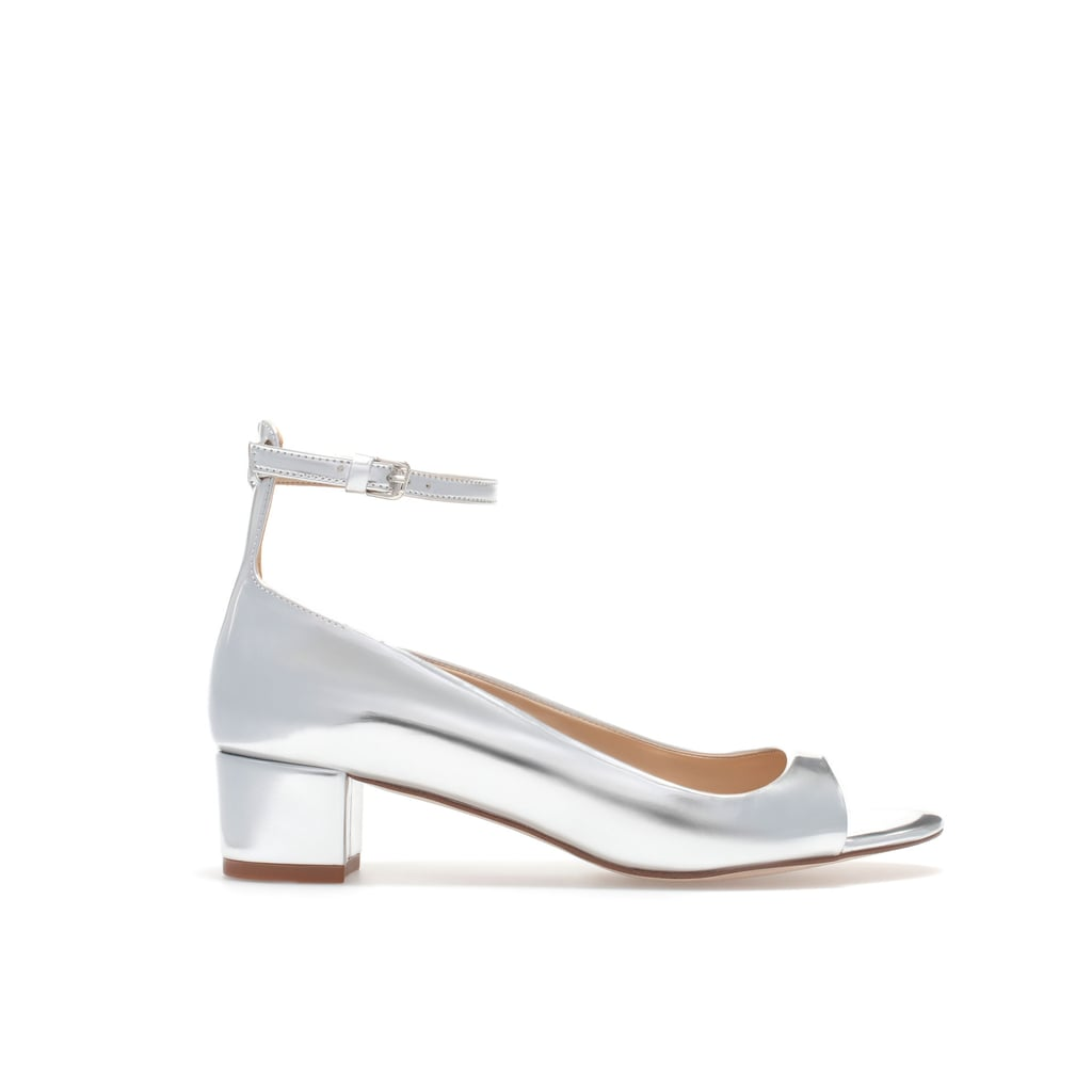 This season's low heel in an attention-getting metallic, thanks to Zara's silver ankle-strap sandals ($80).