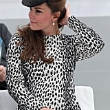 Kate Middleton smoothed her hair down.