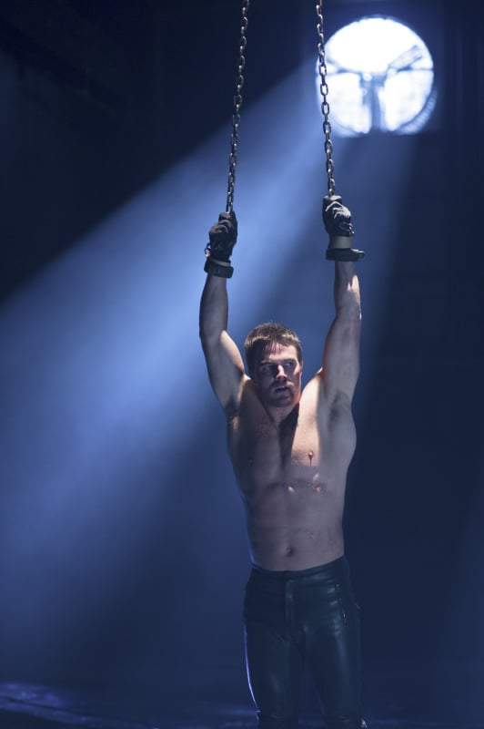 The Arrow season finale airs on May 15, and we can't wait to see what happens to Oliver — who looks to be shirtless for most of the episode. With Oliver in chains, things seem to get messy when Malcolm and John show up. Anxiously awaiting the final episode? Get a sneak peek of the season finale pictures now!