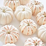 Bronze stripes made with paint or tape make these white pumpkins pop!