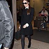 Victoria in a collared airport dress traveling in 2012.