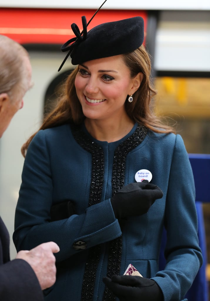 "Kate Middleton received a ""Baby on Board"" pin from an official during her royal visit."