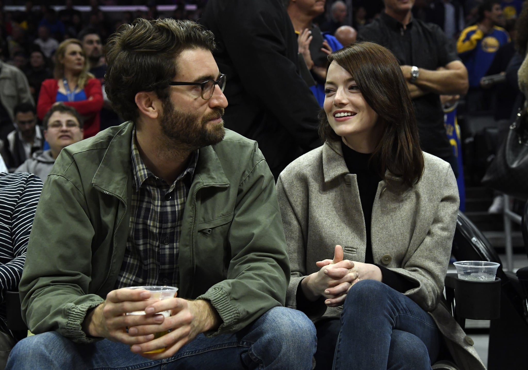 LOS ANGELES, CA - JANUARY 18: Emma Stone and Dave McCary attend the Golden State Warriors and Los Angeles Clippers basketball game at Staples Centre on January 18, 2019 in Los Angeles, California. NOTE TO USER: User expressly acknowledges and agrees that, by downloading and or using this photograph, User is consenting to the terms and conditions of the Getty Images Licence Agreement. (Photo by Kevork Djansezian/Getty Images)