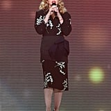 Sporting a '40s-inspired Miu Miu dress in 2011 for Oprah's farewell.