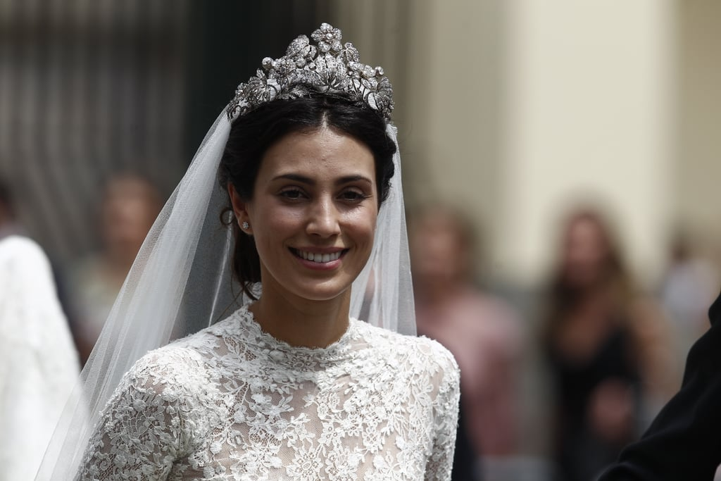 Her High-Neck Gown Featured Intricate Lace Details