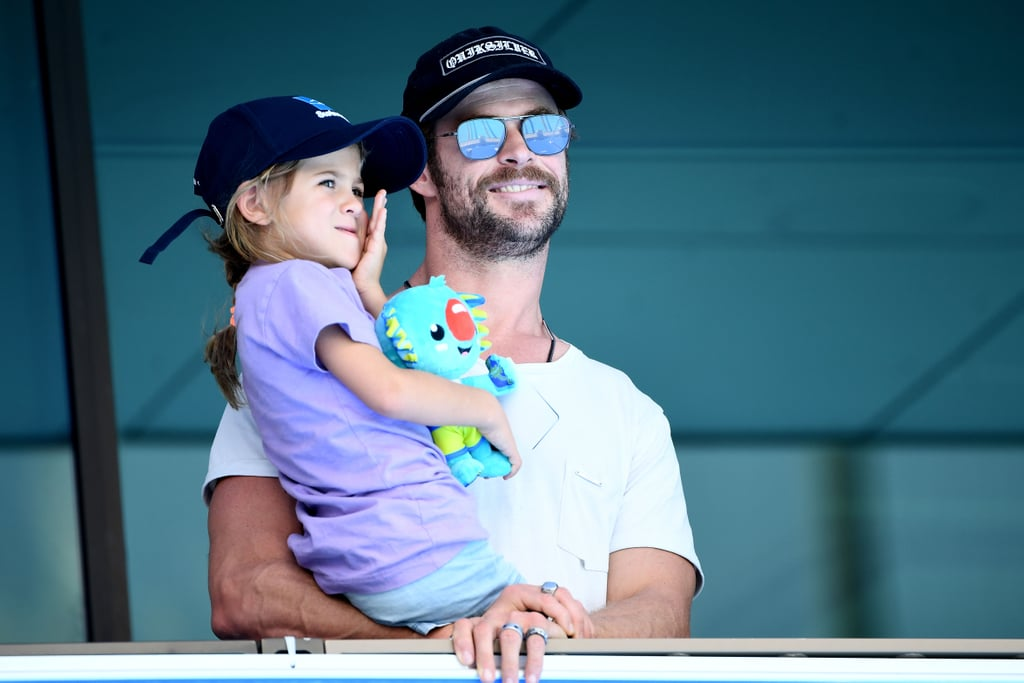 Chris Hemsworth and his 5-year-old daughter India had a ball while watching the swimming competitions at the Gold Coast 2018 Commonwealth Games in Australia on Saturday. The Avengers: Infinity War star held on to his little girl as they took in the events at Optus Aquatic Centre, and at one point, India got to meet Australian backstroke swimmer Emily Seebohm, who chatted with her in the stands. India looked happy to get some solo time with her dad; she has two twin brothers, 4-year-old Tristan and Sasha. Chris and India's father-daughter date comes just a week after the hunky actor was spotted living it up on the beach in Byron Bay with his wife, Elsa Pataky, and family friends Matt and Luciana Damon on Easter Sunday. The couples looked to have a blast as they splashed in the ocean with their kids and drank beers on the shore. Chris and Elsa even caught some alone time and sneaked in some sweet PDA. While Chris happened to have a shirt on during his day out with India, you can check out all the times he wasn't wearing one, right here.