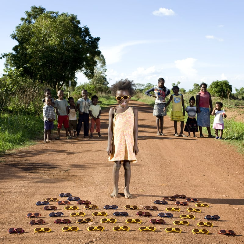 """In addition to their favorite toys, the children came with special stories about their prized possessions. There was one moment in particular that Galimberti found extremely memorable.  """"I was in this little village in the north part of Zambia, a place where there is almost nothing,"""" Galimberti recalls. """"No electricity, no running water, and of course no toy stores."""" For these children, Galimberti notes, playtime means running outside with other kids and creating toys out of the things they find in nature. He had all but given up hope on finding a suitable subject, but luck — and perhaps a not-so-secure truck — was on his side.   """"Maudy had found a box full of sunglasses on the ground along the main road,"""" Galimberti says, noting that the box most likely fell off a truck, """"so all the children of the village were playing with these glasses."""" The children were delighted to have something other than sticks and stones to play with, even if it wasn't a typical toy. Source: Gabriele Galimberti/INSTITUTE"""