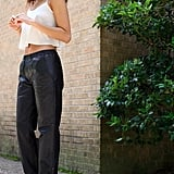 Cool-girl leather sweatpants are the perfect piece to juxtapose with a breezy cropped tank. Source: Instagram user smashleybell