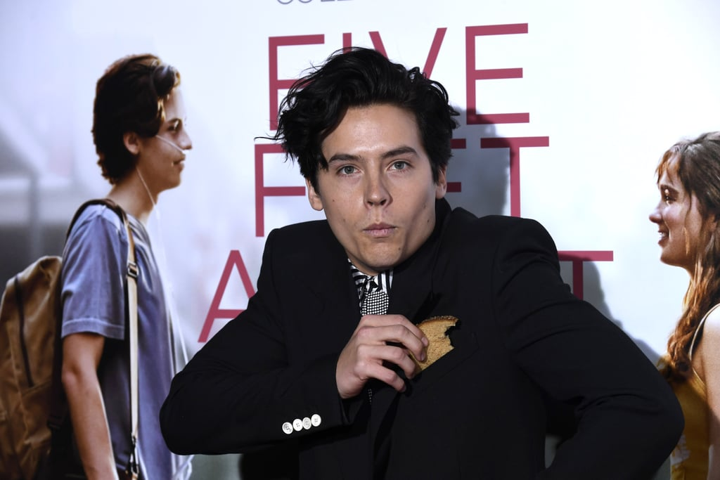 """Cole Sprouse isn't the first celebrity to go against the grain (pun intended) and keep snacks in his pocket, but his love of bread has officially reached a new level. On Friday, he attended the LA premiere of his new movie, Five Feet Apart, with a slice of bread in his pocket — and it looks like it's multigrain? During an interview on The Late Late Show with James Corden that same day, James referenced a photo of Cole with two fans, and pointed out a slice of what looks like ciabatta bread in the front pocket of his shirt. """"You know, I'd prefer if we didn't go into my personal life, if that's OK,"""" Cole said. """"I think it should become your thing, where you're never seen [without bread],"""" James insisted. OK, the image of that in my head alone is enough to make me laugh, but Cole actually followed through! """"I've got a premiere tonight,"""" he told James. """"If you guys got some bread back stage, I can put a little bread in my pocket."""" Cole clearly stayed true to his word as he posed with a slice of multigrain bread that he'd already taken a bite out of, because seriously, who can resist bread? We may not know why Cole had that first slice of bread in his pocket to begin with, but at least he isn't afraid to get his multigrain on. Who knows? Maybe we can expect to see him holding a baguette or a croissant clutch in the future.      Related:                                                                                                           Cole and Dylan Sprouse Shared an Adorable Brotherly Moment at the Five Feet Apart Premiere"""