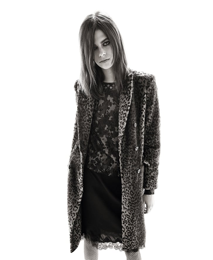 Print mixing in a leopard-print coat, camo cashmere sweater, and romantic lace-hem skirt