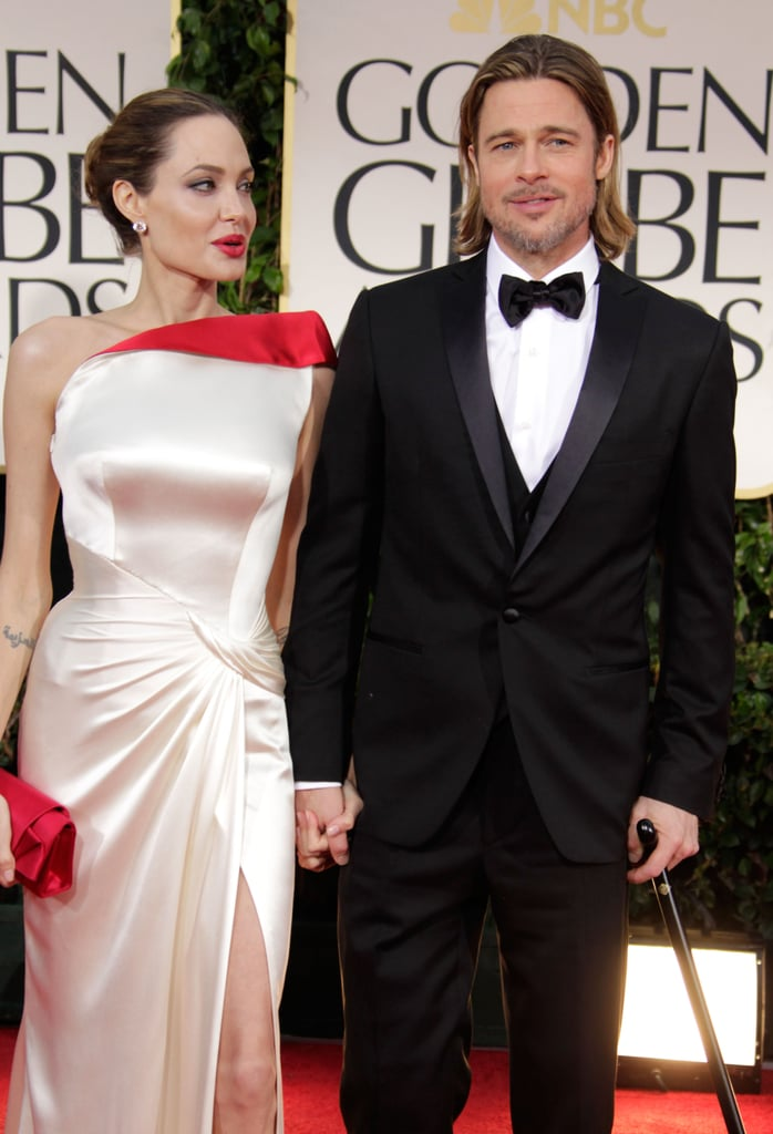 Angelina Jolie looked at Brad Pitt on the red carpet.
