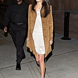 Amal was right on trend when she layered a suede coat over a flouncy lace dress and completed the look with white ankle-strap sandals.
