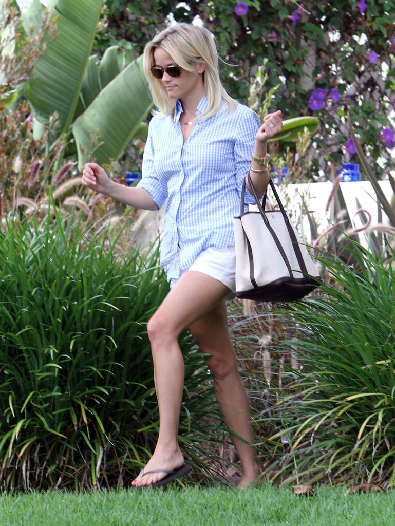 Reese Witherspoon and her husband, Jim Toth, got lunch yesterday in LA, but she was later solo, in a button-down and short white shorts, to get coffee. She hopped back in her SUV after picking up the drink, then headed to visit a friend's home. Reese is home again in California following her end-of-Summer vacation in Hawaii with Jim and children Ava and Deacon. She and Jim may be interested in purchasing an oceanside pad closer to home — Reese checked out Brad Pitt's Malibu mansion, which is on the market for $14 million, earlier this week. Reese also had time for lunch with Taylor Swift a few days ago. Reese and Taylor talked about their mutual ex Jake Gyllenhaal, reportedly saying that he can be vain and self-absorbed!