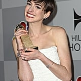Anne Hathaway got giddy with her Golden Globe award.