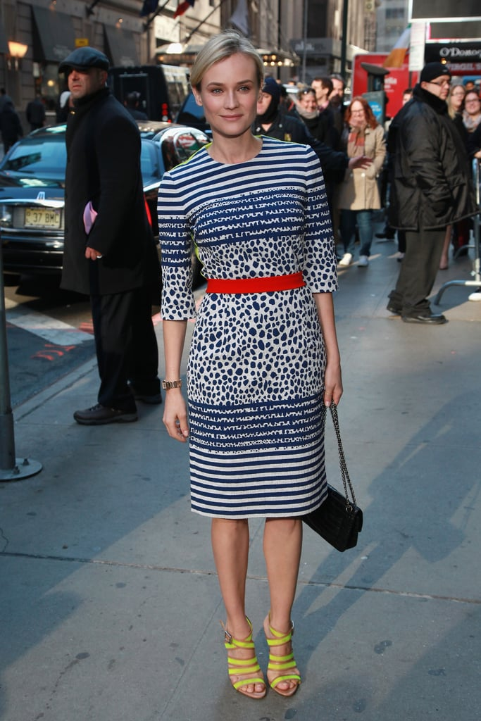 While heading to Good Morning America in NYC, Diane Kruger took her jacquard Preen number to new heights via strappy neon Loeffler Randall sandals.