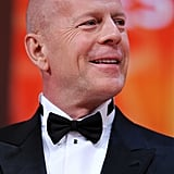 Bruce Willis smiled at the opening ceremony of the 65th annual Cannes Film Festival.