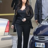 Kim Kardashian walked out of a store in Paris with Kanye West close behind.