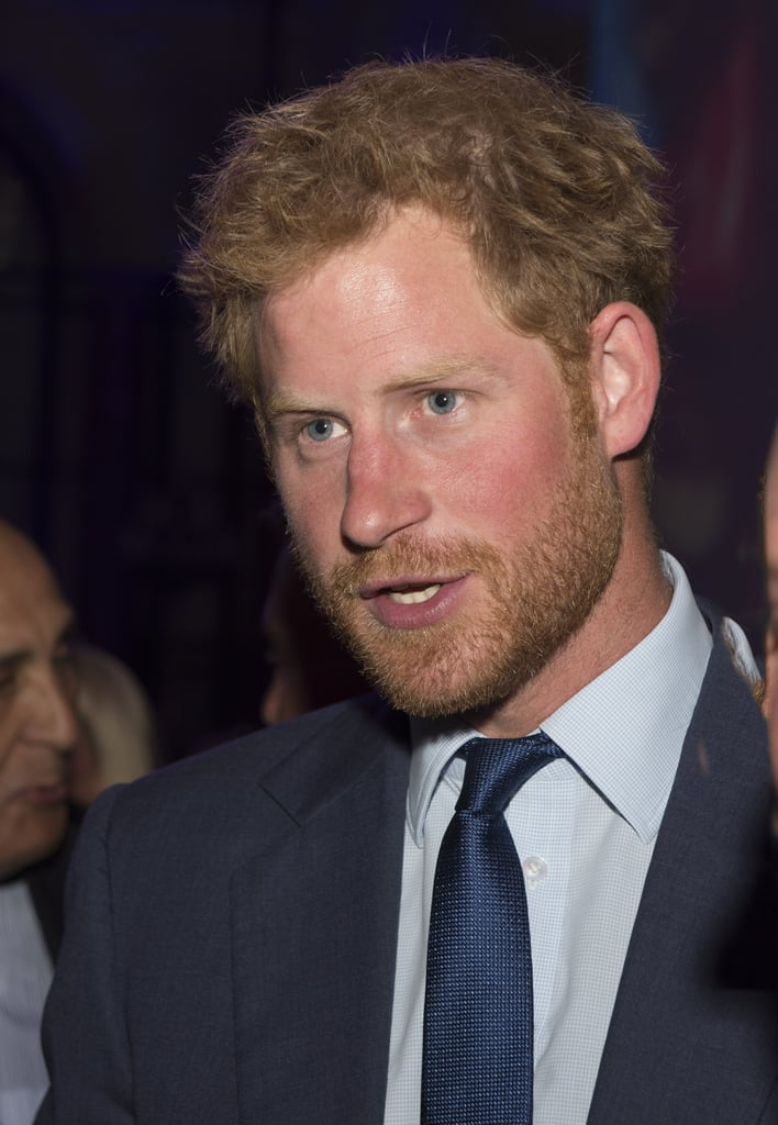Prince Harry Steps Out With His Scruff, His Suit, and His Baby Blues