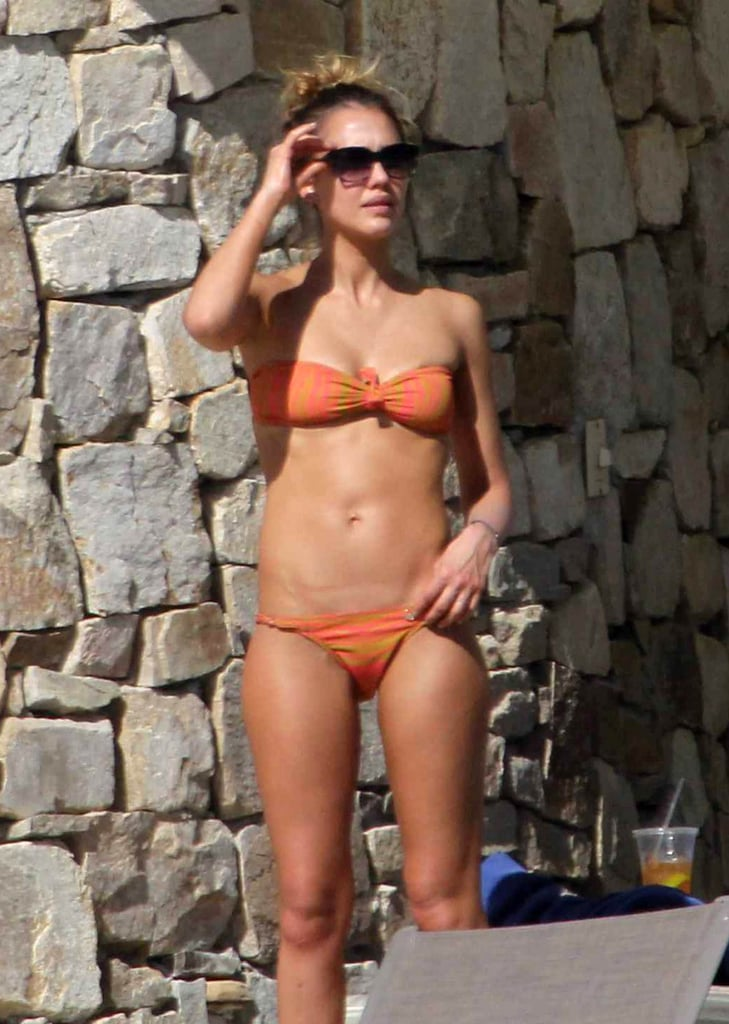 In January 2013, she worked on her tan in Cabo while wearing a bandeau bikini.
