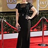 Kelly Osbourne kept it sleek in a black Jenny Packham gown and Brian Atwood pumps. The sheer stud-embellished bodice — talk about seriously edgy! — complemented a crystal-studded Marchesa clutch and Kelly McDonald jewels.