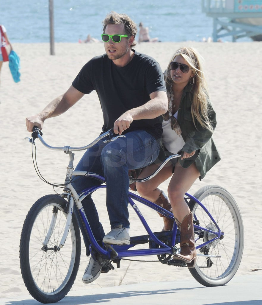 Jessica Simpson and Eric Johnson rode a tandem bike along the boardwalk in Venice Beach, CA, yesterday. Eric sported his usual neon shades while Jessica wore a pair of sturdy cowboy boots and short shorts for their afternoon by the water. The pop star and Jessica Simpson Collection designer was back in sunny LA after traveling to Denver to sing for military families, and then stopping in Chicago with her fiancé, earlier this month. Now that the couple are home, they've set a date and are planning their upcoming nuptials. Jessica and Eric have kept mum on most of the details about the big day, but Jessica did hint that she'll seek out a wedding gown that shows off her famous assets. Jessica Simpson also downplayed wedding fitness regimen reports, joking that she'd be just as happy getting married in sweatpants.