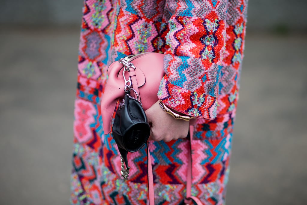 Clasp a playful pouch onto your larger bag, just like this Loewe pairing.