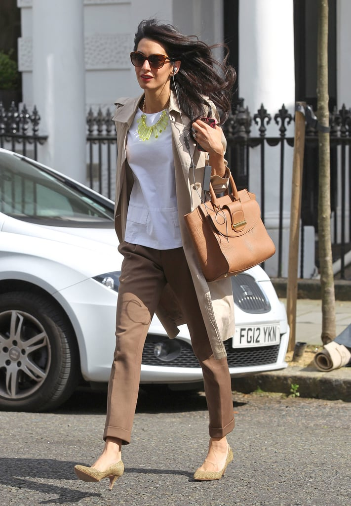 Amal's caramel-colored trousers added a luxe touch to her playful lucite necklace.