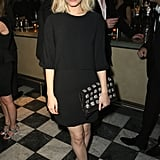 Kate Mara went for a black look.