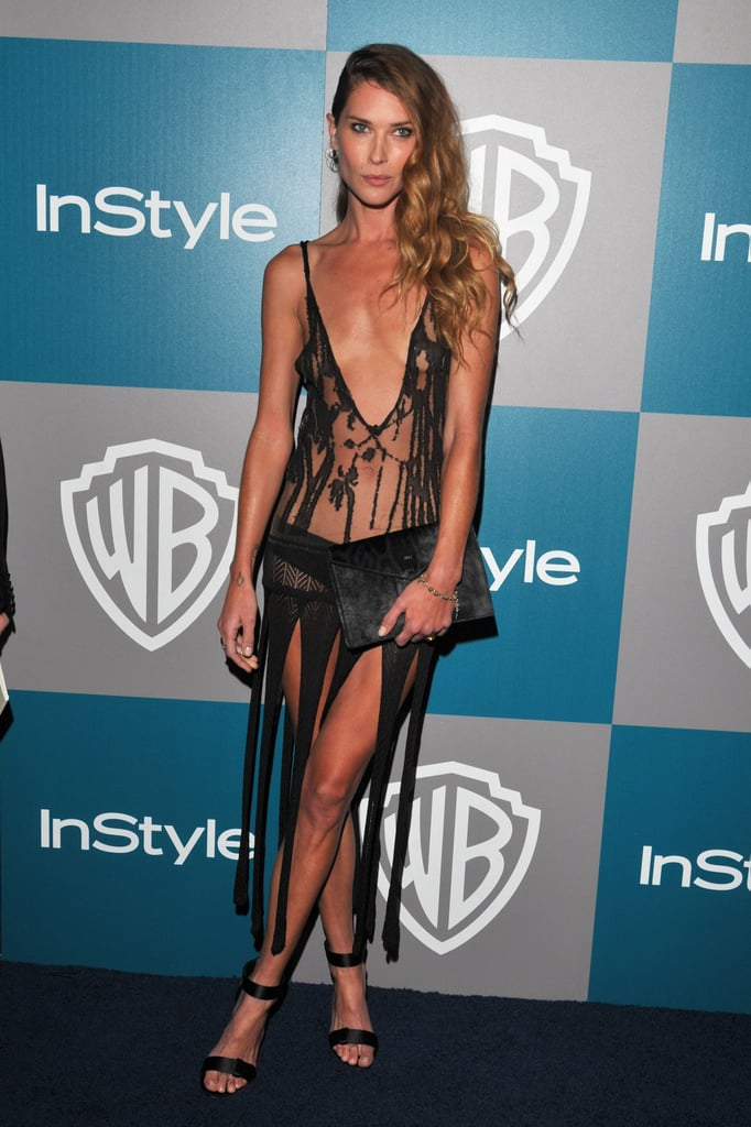 Model Erin Wasson definitely caught our attention in this barely there number. From the deep-V sheer and burnout front details to the strips of black fabric that serve as the skirt, this dress made it official: Erin dared to show off some skin at the Globes InStyle afterparty.