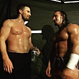 Amell showing off those hard-earned abs at WWE's Summer Slam.
