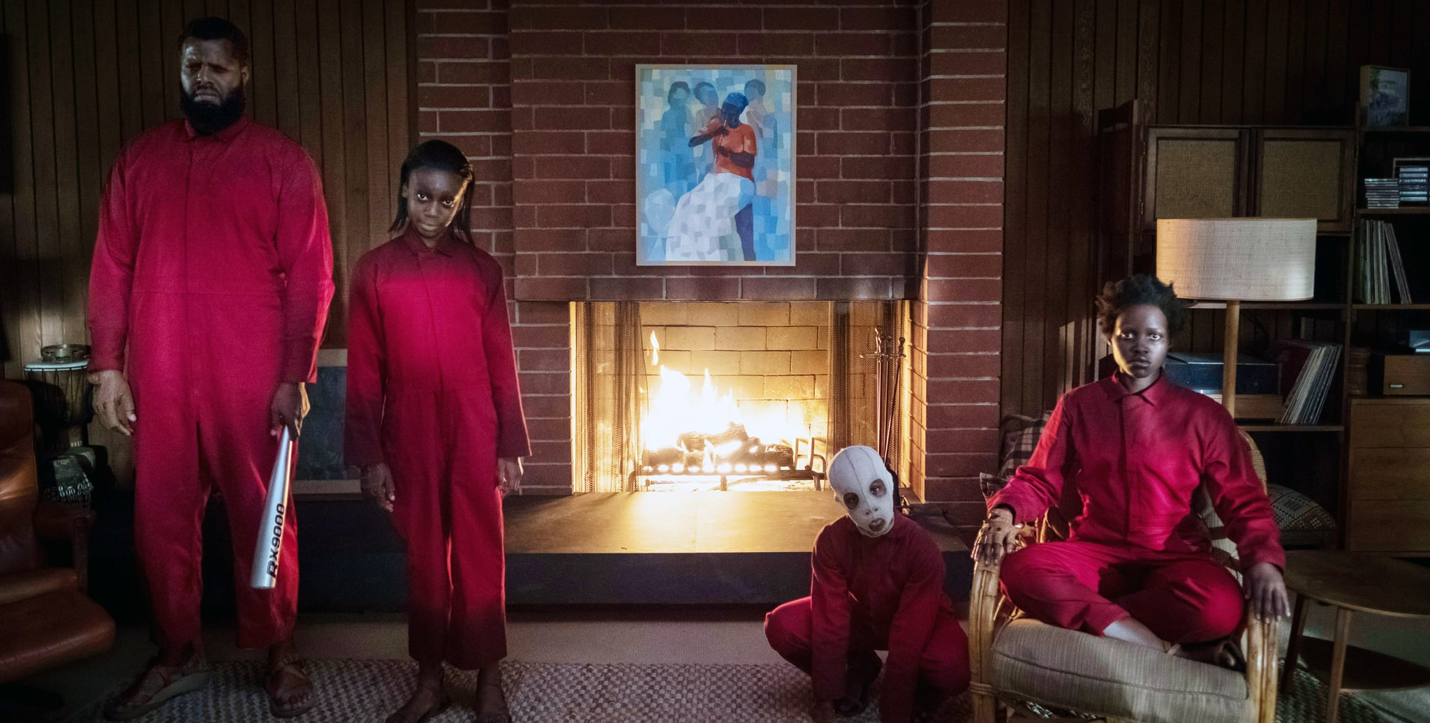 US, The Wilson family doppelgangers as portrayed from left:  Winston Duke, Shahadi Wright Joseph, Evan Alex (wearing mask), Lupita Nyong'o, 2019. ph: Claudette Barius /  Universal / courtesy Everett Collection