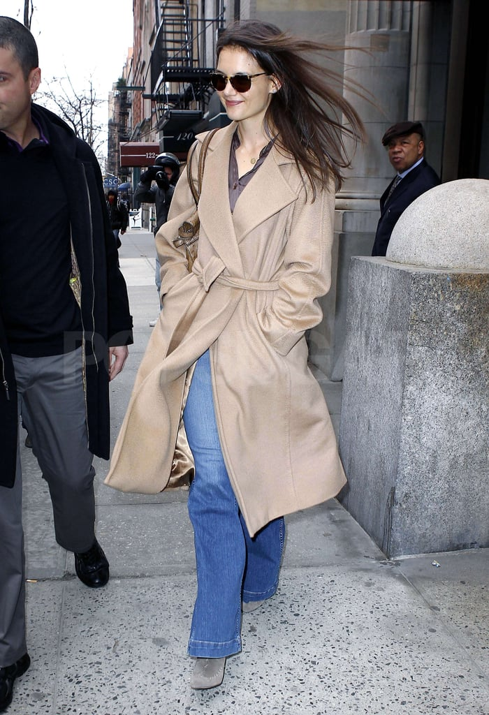 Katie Holmes left her apartment in windy NYC today in a camel coat. The actress was solo this afternoon, but brought Suri Cruise as her date last night to see a Broadway show. The mother-daughter duo returned to the Big Apple after spending some time with Tom Cruise in Vancouver, where he was working on Mission Impossible: Ghost Protocol. Tom's girls paid him a visit on the set, and he took advantage of a break from work to join them for a fun day out at the city's science museum.