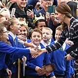 Kate shook hands with a young girl before leaving a reception at the National Football Museum in Manchester in October 2016.