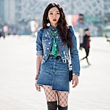 Style a Denim Skirt With a Matching Jacket and Fishnet Stockings