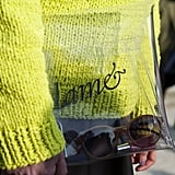 A clear clutch injected a little whimsy against a neon yellow knit sweater.