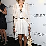 She might be a torchbearer for the polished, uptown look, but the loose white dress she wore to the Spring 2014 BCBG Max Azria show makes it clear she could pick something suitable for a barefoot beach wedding, too.