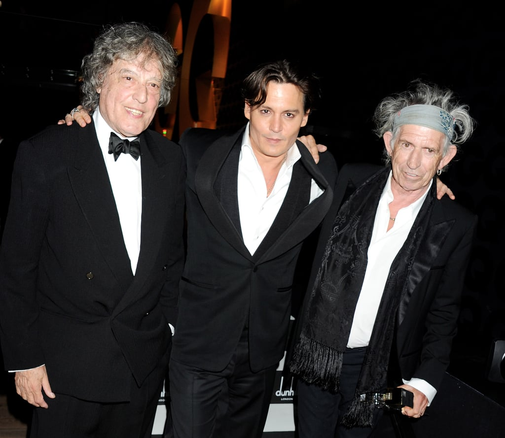Johnny Depp smiles with Keith Richards and Tom Stoppard.