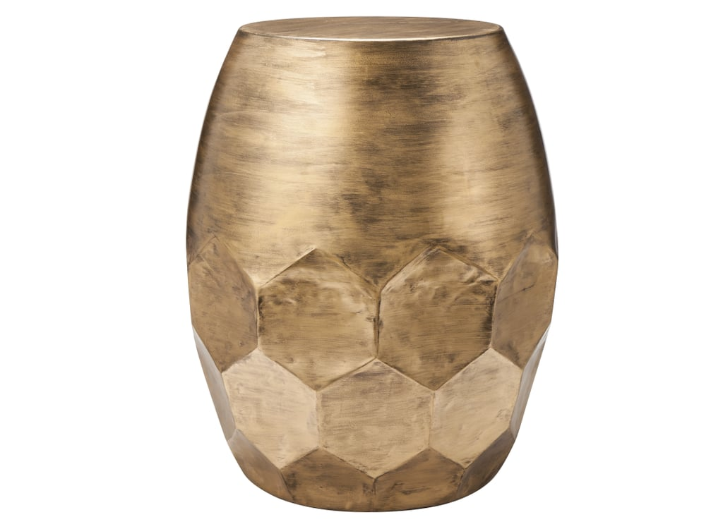 The honeycomb base of this accent table ($80) adds unexpected texture.