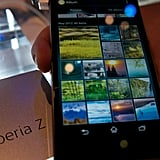 Xperia's photo gallery sorts photos by month in a grid view.
