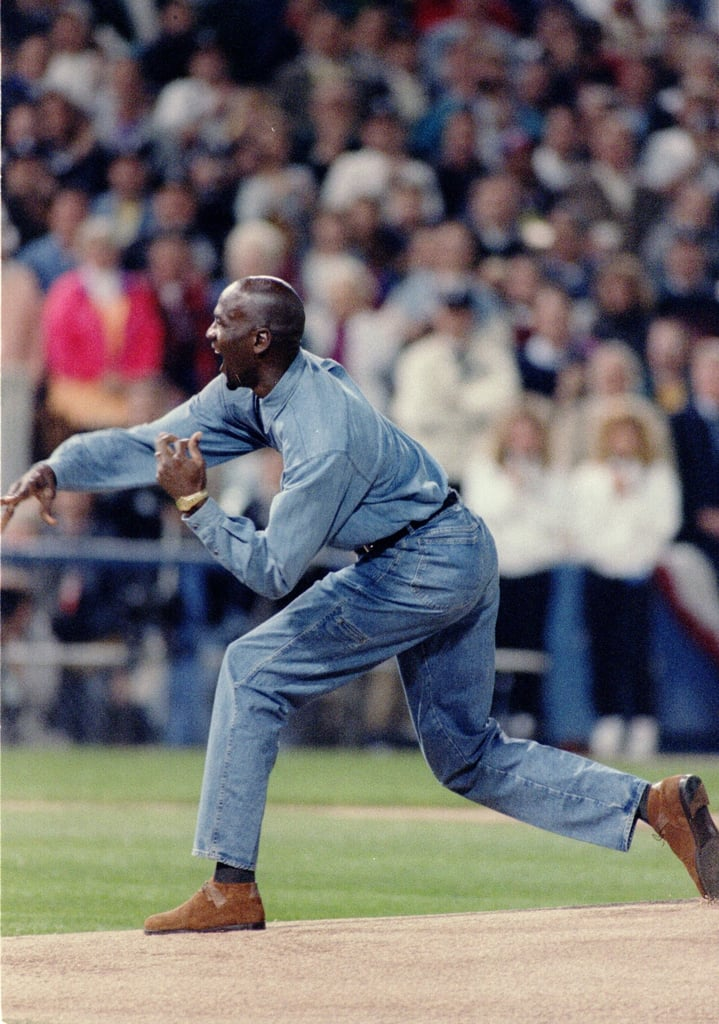 Michael wore head-to-toe denim, brown suede shoes, and a timeless gold watch while throwing the first pitch at a 1993 ALCS playoff game.