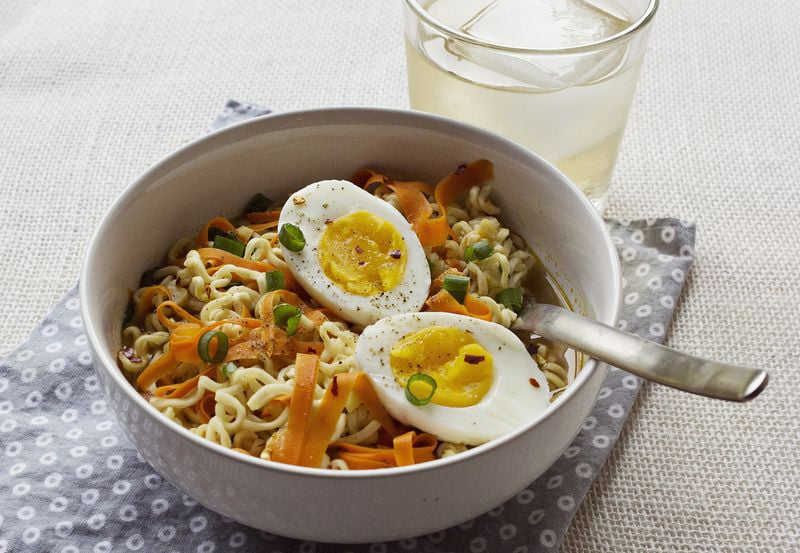 Ramen With Soft Boiled Eggs Scallions And Carrot Ribbons