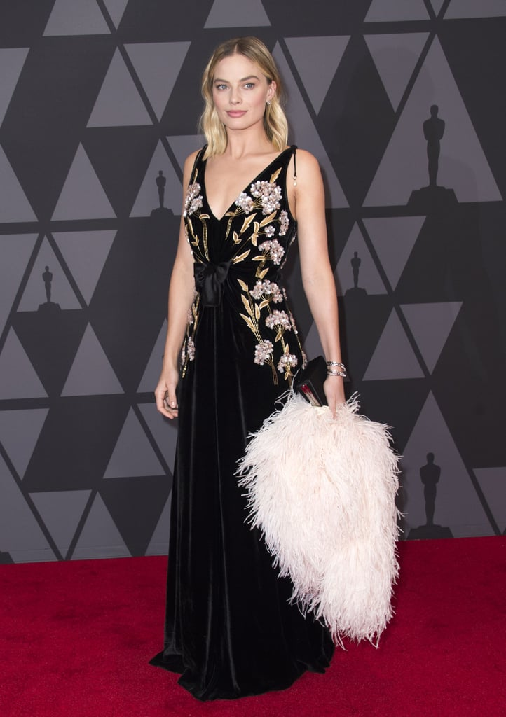 Margot's stunning look with feathered boa came courtesy of Prada and Altuzarra at the 2017 Governors Awards.