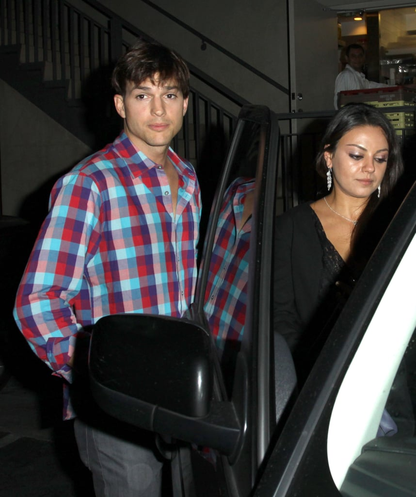 Ashton Kutcher and Mila Kunis hopped into their car after hanging out in LA last night. The couple went casual to stop by the restaurant and club Duplex, where his costars and crew from his Steve Jobs movie were apparently throwing a wrap party. The couple tried to leave unnoticed by going through a back door. It was Ashton and Mila's latest jaunt out on the town. Over the weekend, their romance was confirmed when they were photographed kissing at a different event for the Jobs film. Mila and Ashton are spending plenty of time together. Monday also brought a chance for Mila and Ashton to go on a date, with an outing to see The Dark Knight Rises.